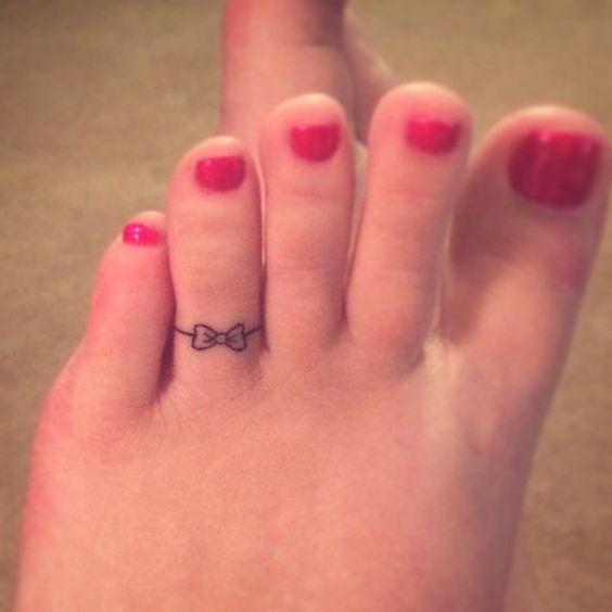 A bow tattoo on women toe
