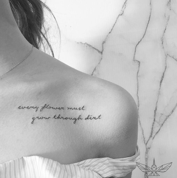 Inspiring script on women collarbone tattoo