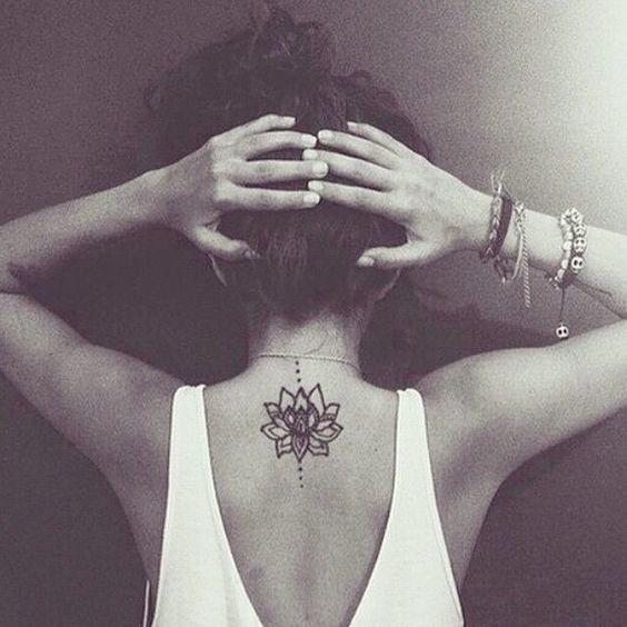 Breathtaking lotus flower tattoo on the neck