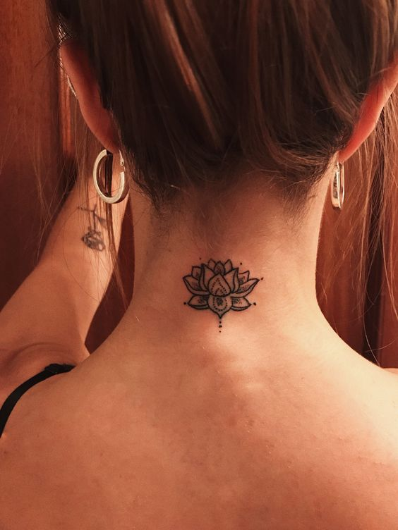 Cute lotus flower tattoo on the back of neck