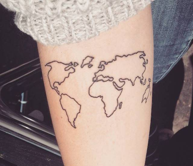 Map of the world tattoo on forearm