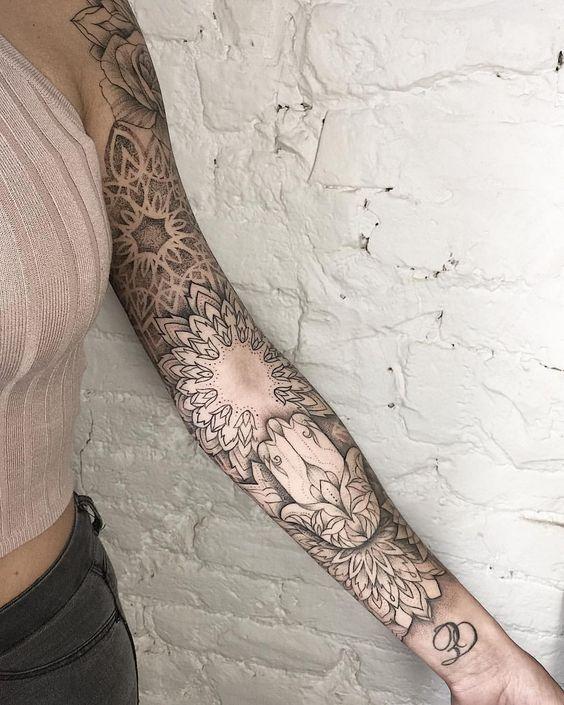 Most eye catching mandala arm tattoo
