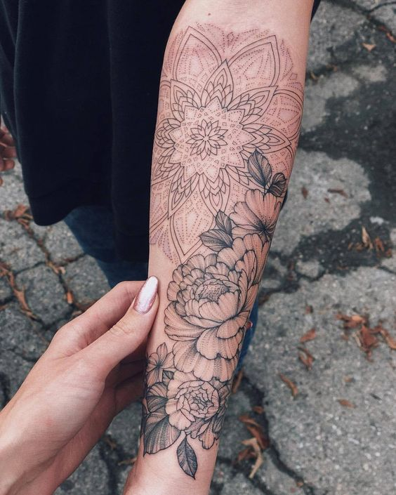 With meaning mandala tattoo on women arm