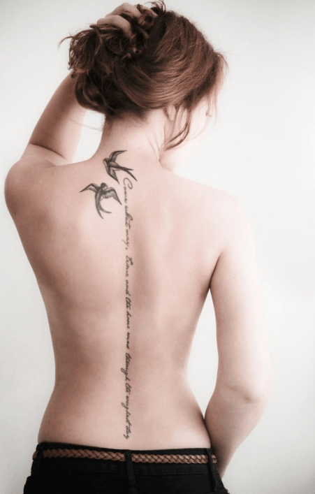 Awesome swallow neck and spine tattoo
