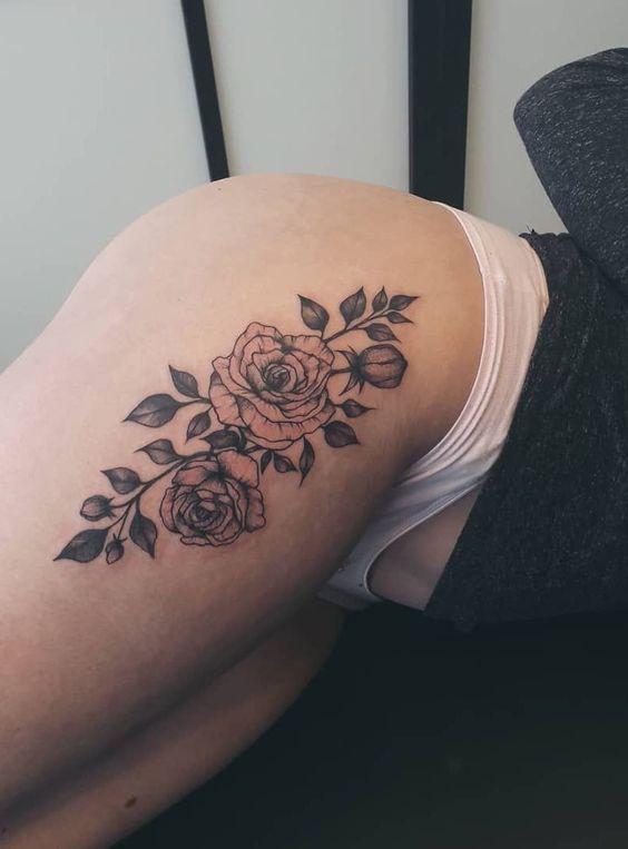 Beautiful roses tattoo on women thigh