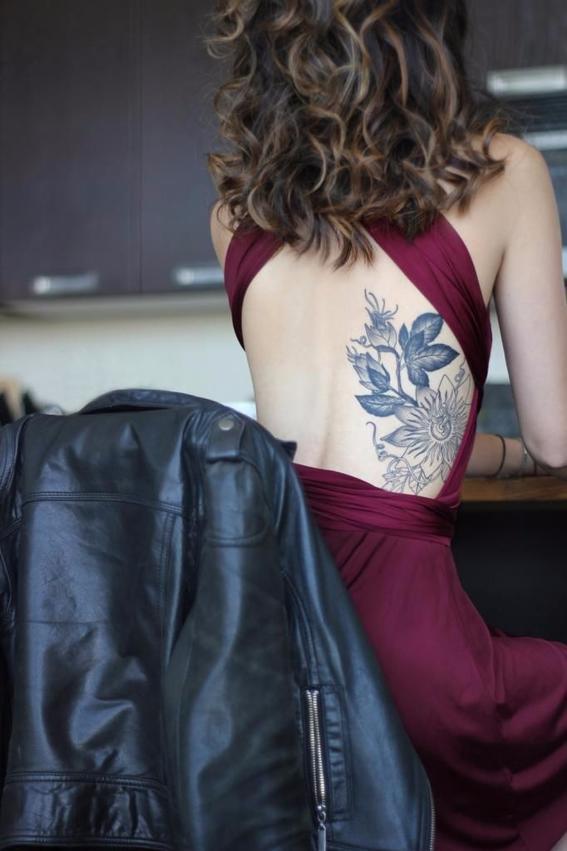 Breathtaking flower on rib tattoo