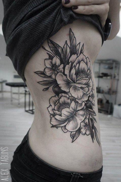 Mind blowing rib tattoo for women