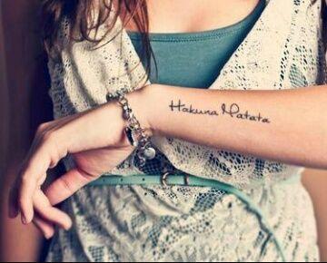 No worries tattoo on arm
