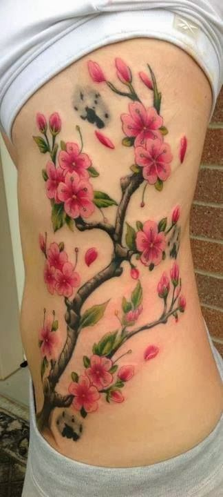 Pink floral rib tattoo for women