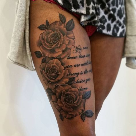 Rose with script tattoo on thigh
