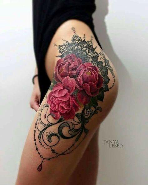 Sensual red rose tattoo on leg