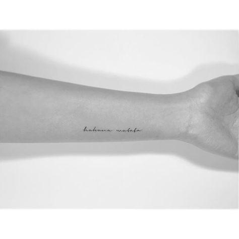 Small hakuna matata tattoo on arm