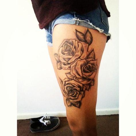 Three roses tattoo on thigh