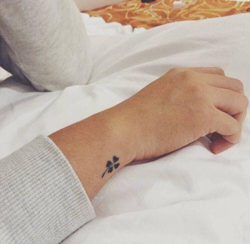 Tiny clover design tattoo on wrist