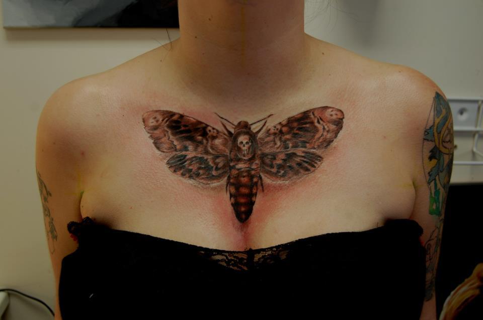 Girl chest moth tattoo for women