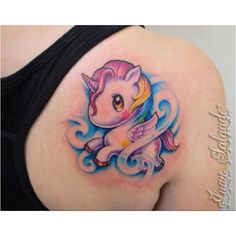 Colorfull cute pegasus on back tattoos