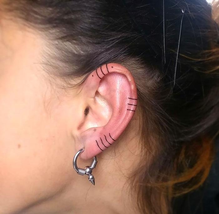 Just line and dots ear lobe tattoo