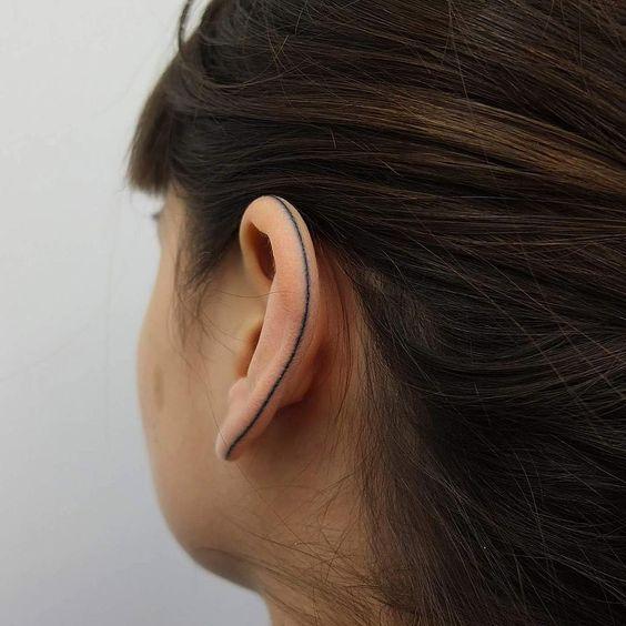 One simple line tattoo on ear
