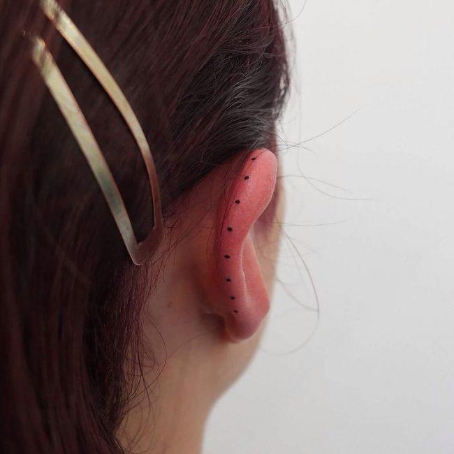 Stylish ear lobe tattoo