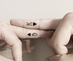 Card symbol king and queen tattoo on finger