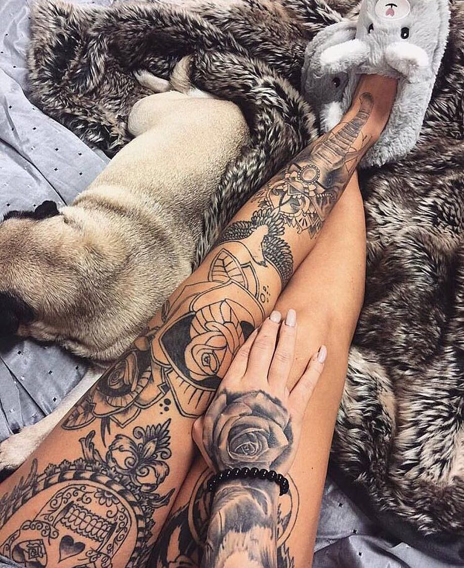 Flowers and animals tattoo on thigh