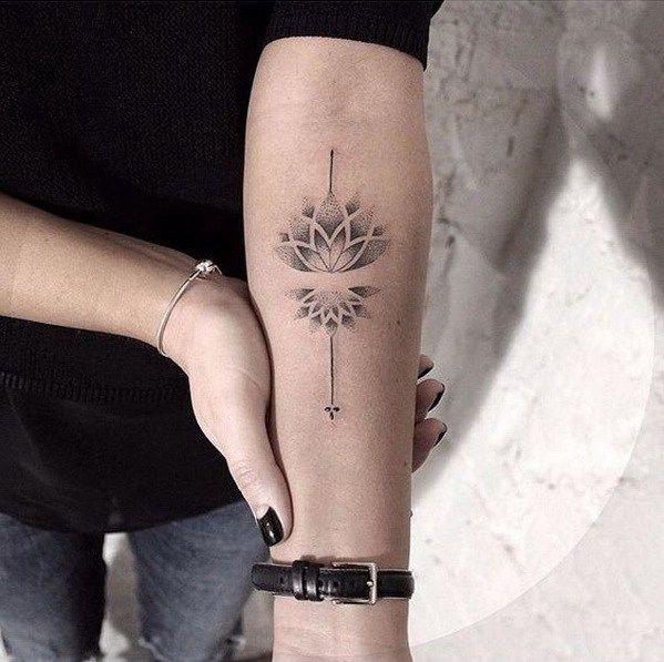 Lotus flower dot tattoo on arm