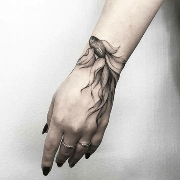 Amazing fish tattoo on wrist