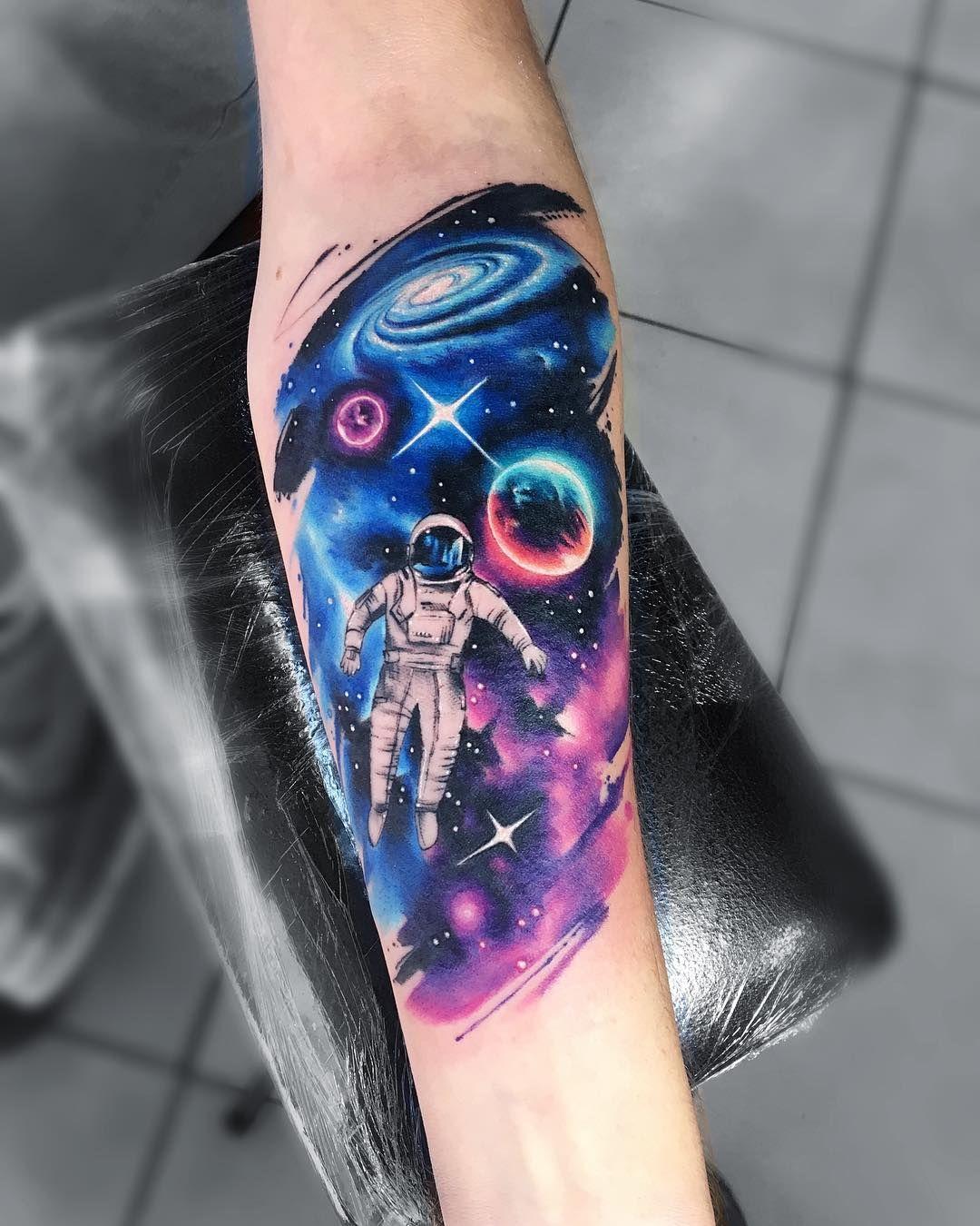 Astronaut in space tattoo ideas