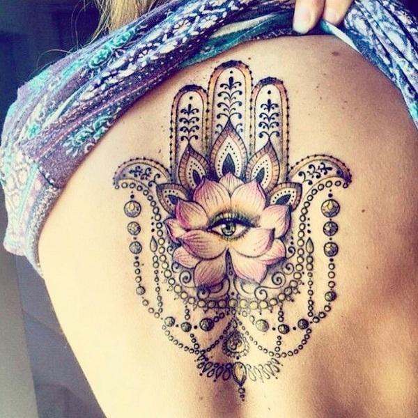 Hamsa back tattoo for women