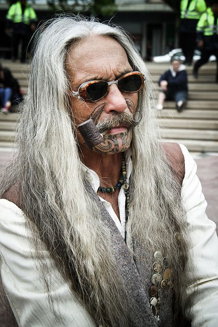 Senior with tattoo on his beard