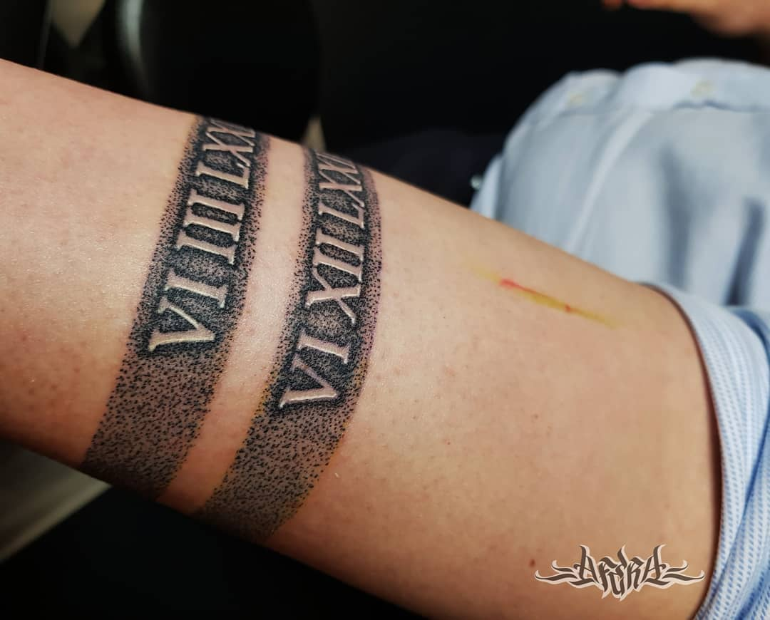 Armband with roman numerals tattoo