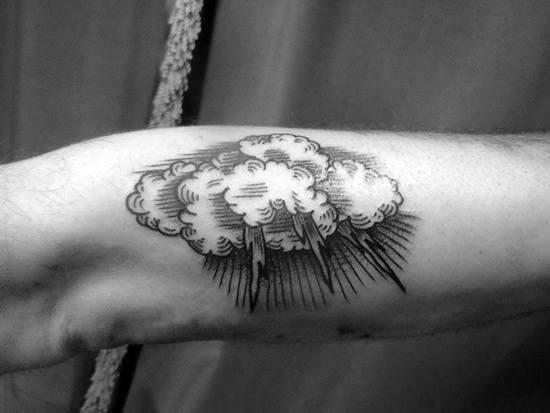 Cloud and lightning tattoo on arm
