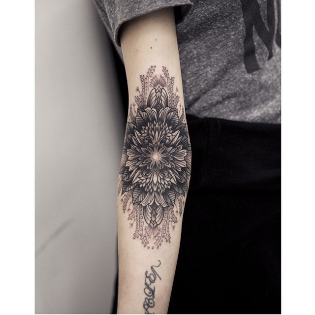 Good flower on elbow tattoo