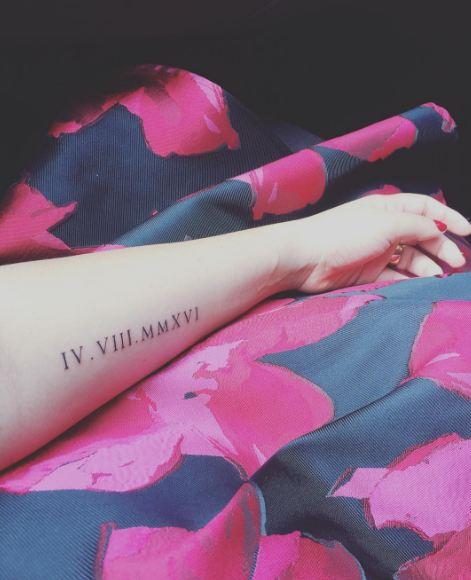 Long size roman number tattoo
