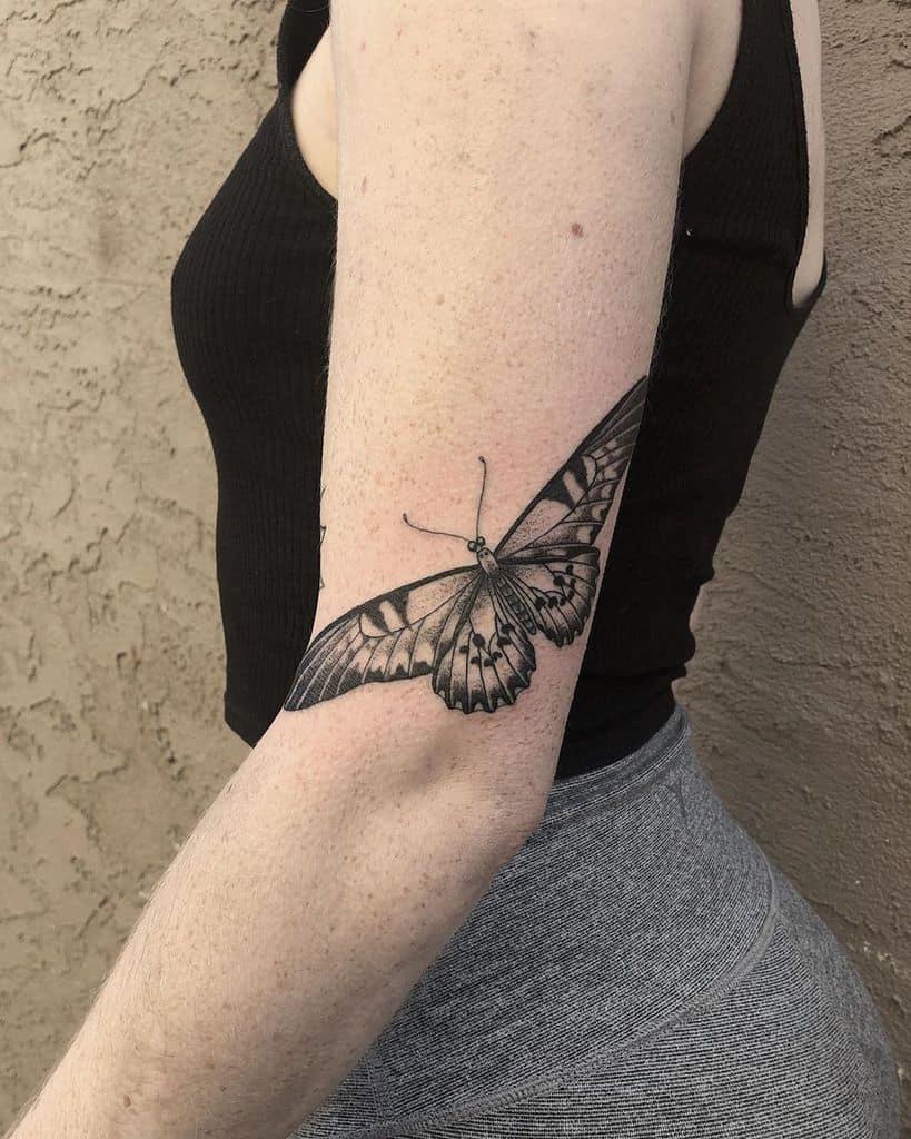 Moth tattoo on elbow