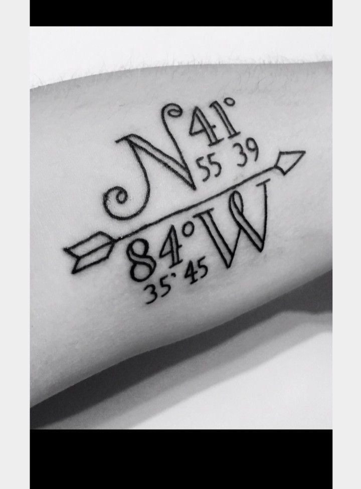 Coordinate number tattoo and arrow
