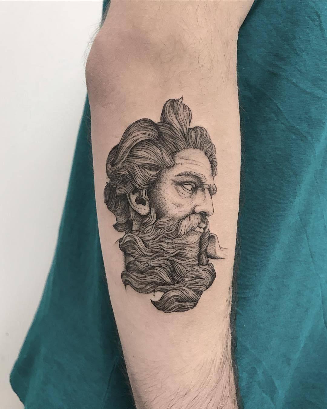 Zeus tattoo on arm