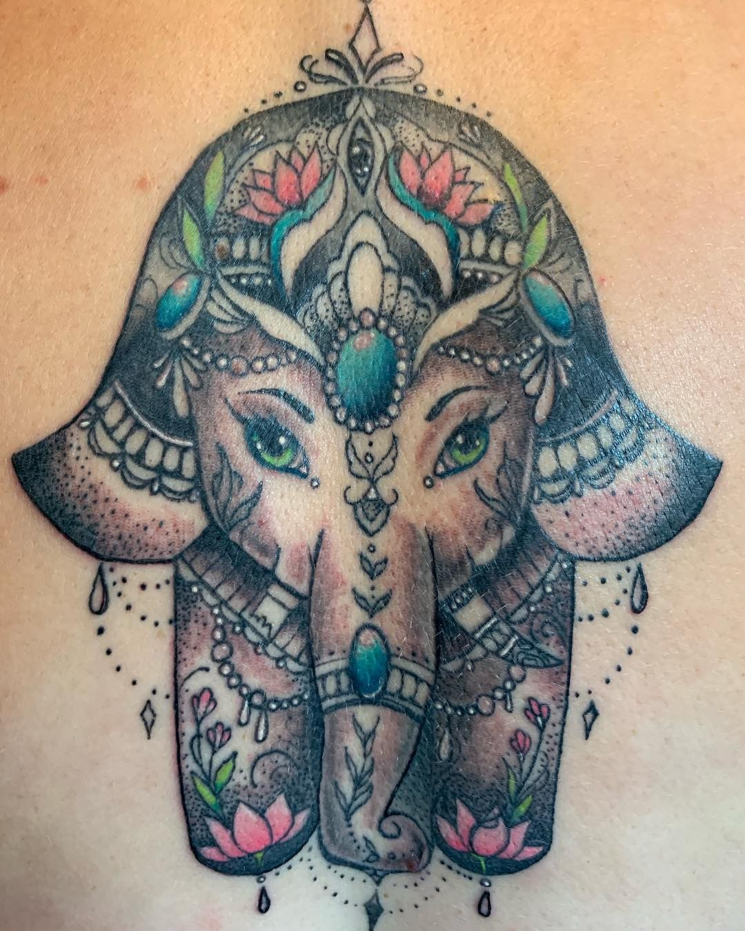 Cute Ganesha in Hamsa hand shape tattoo