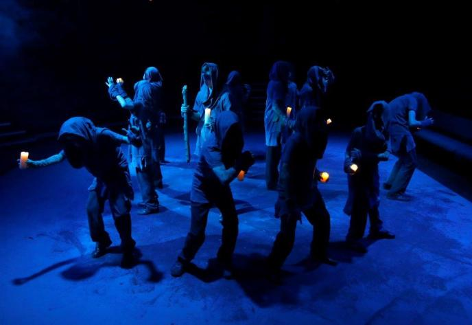 Macbeth witches holding lanterns