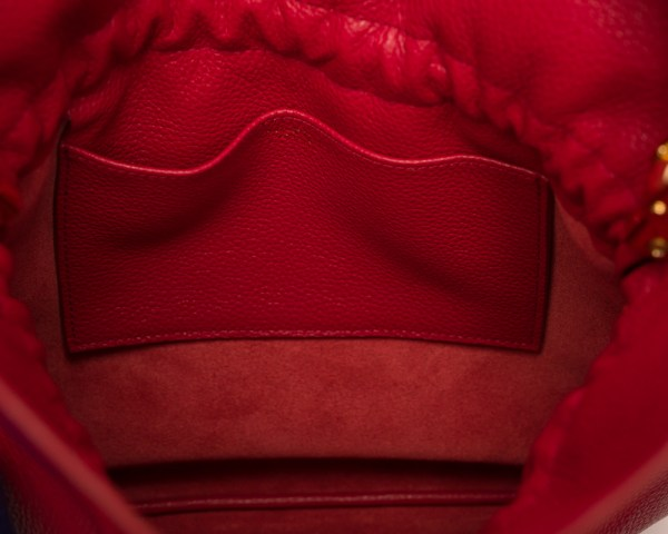 Atelier de Corium - Caramella in Lollypop Red hanging inside