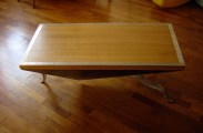 Table basse en métal, bois et inox