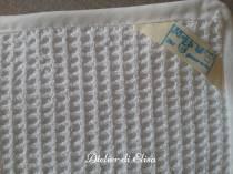 Dettaglio asola asciugamano
