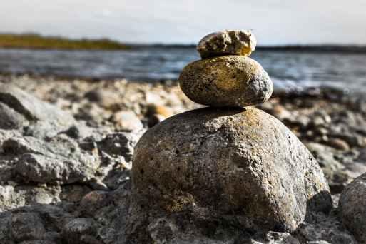 stacking brown stones