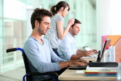 Man in wheelchair using a computer