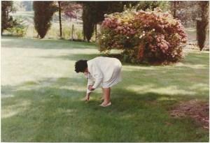 Mom picking mushrooms