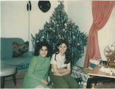 My cousin, Nancy and I sitting under the tree.
