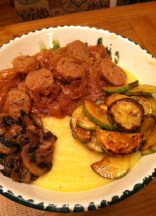 Polenta with sausage, zucchini, and sautéed mushrooms.