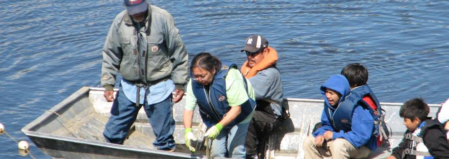 Al and Eleanor Yatlin check their fish net on the Koyukuk River in 2011. Photo by Angela Gonzalez