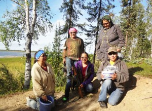 Mom picks blueberries near Huslia. Left-right: Eleanor Yatlin, Dorothy Yatlin, Vanessa Derendoff, Glady Derendoff and Josephine Derendoff. Photo by Al Yatlin, Sr.