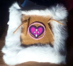 Melanie Wholecheese beaded this pillow for Michelle's wedding. It is made out of moose skin and rabbit fur. Photo by Tanya Yatlin